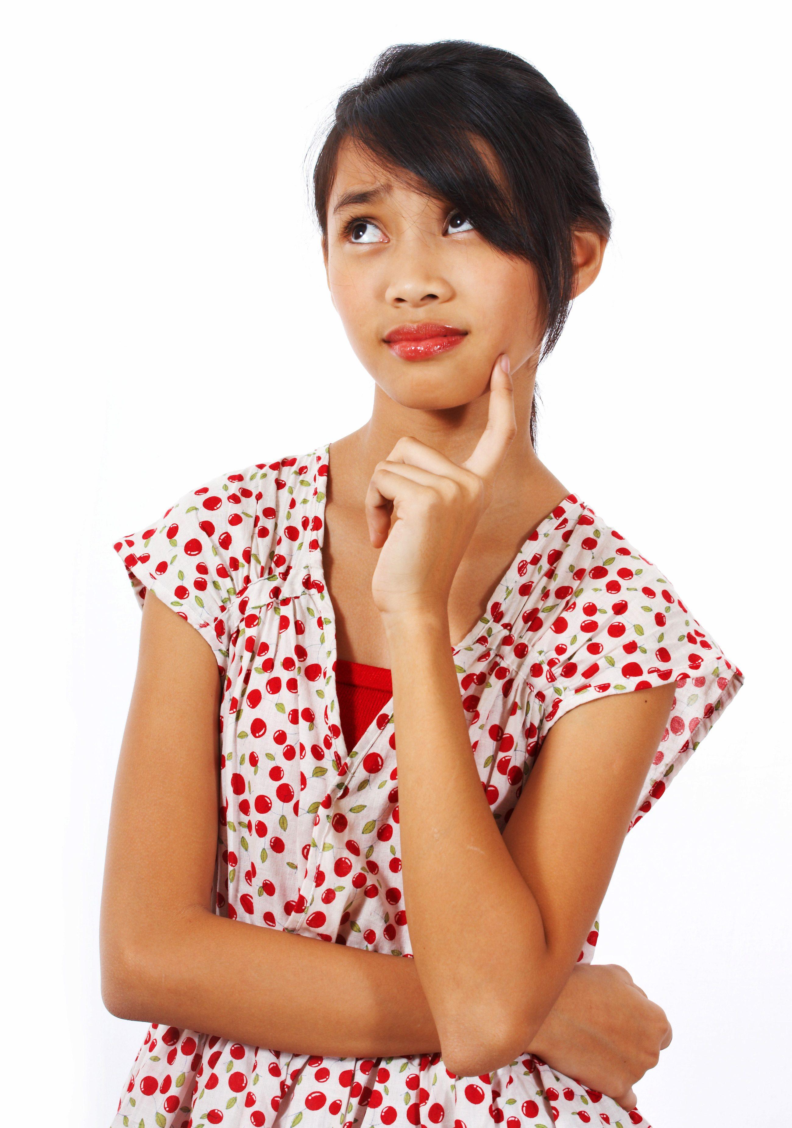 teenage girl thinking about something